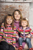 Mother and daughter in colorful knitted sweaters Royalty Free Stock Photos