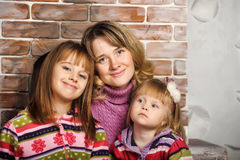 Mother and daughter in colorful knitted sweaters Royalty Free Stock Photo