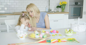 Mother and daughter coloring eggs Royalty Free Stock Photography