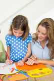 Mother and daughter coloring Royalty Free Stock Photo
