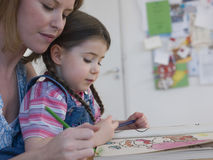 Mother And Daughter Coloring At Home Stock Photos