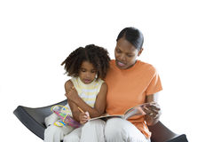Mother and daughter colouring picture in book with felt tip pen, cut out Stock Images