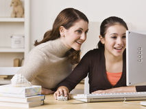 Mother on Daughter on Computer Royalty Free Stock Photography