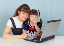 Mother and daughter with computer Royalty Free Stock Photography