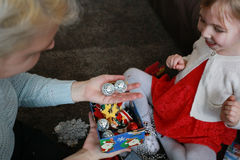 Mother and daughter consider Christmas decorations Royalty Free Stock Image