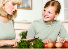 Mother and daughter cook food Royalty Free Stock Photo