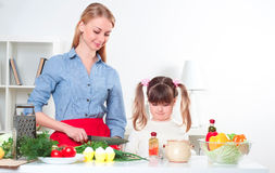 Mother and daughter cook together Royalty Free Stock Photo