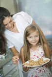 Mother and daughter with cookies Royalty Free Stock Photo
