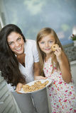 Mother and daughter with cookies Stock Photo