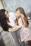 Mother and daughter with cookies Royalty Free Stock Photos