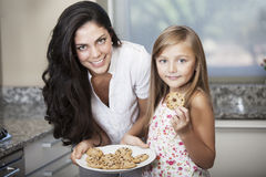 Mother and daughter with cookies Stock Image