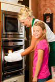 Mother and daughter cooking royalty free stock image
