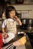 Mother and daughter cooking stock photography