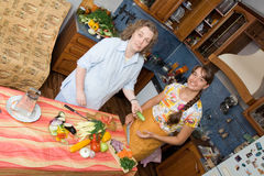 Mother with daughter cooking Stock Photos