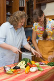 Mother with daughter cooking Stock Photo