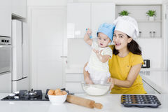 Mother and daughter cooking bakery together Stock Photo