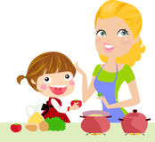 Mother and daughter cooking Stock Photo