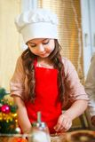Mother and daughter cooking Christmas cookies in kitchen . stock images