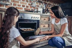 Mother and daughter cooking cookies royalty free stock images