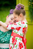 Mother and daughter cooking cupcakes. Young mother and her daughter cooking cupcakes together in the backyard Royalty Free Stock Images