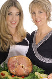 Mother and daughter cooking ham together Royalty Free Stock Photo