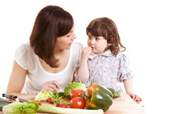 Mother and daughter cooking at the kitchen Royalty Free Stock Image
