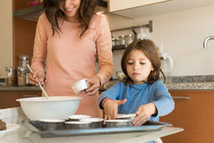 Mother and daughter cooking Stock Image