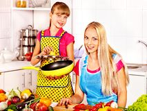 Mother and daughter cooking at kitchen. Stock Image