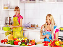 Mother and daughter cooking at kitchen. Stock Images
