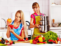 Mother and daughter cooking at kitchen. Royalty Free Stock Image