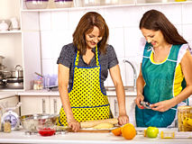 Mother and daughter cooking at kitchen. Stock Photo