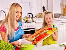 Mother and daughter cooking at kitchen Stock Photo