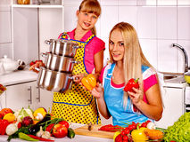 Mother and daughter cooking at kitchen Stock Images