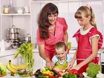 Mother and daughter cooking at kitchen Royalty Free Stock Photos