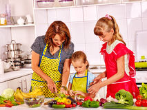 Mother and daughter cooking at kitchen Royalty Free Stock Photography