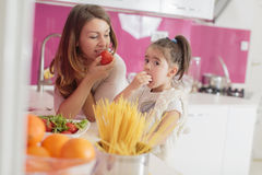 Mother and daughter cooking in the kitchen Stock Image