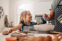 Mother and daughter cooking in kitchen Royalty Free Stock Photos
