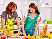Mother and daughter cooking at kitchen Royalty Free Stock Image