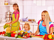 Mother and daughter cooking at kitchen Stock Image