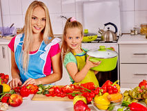 Mother and daughter cooking at kitchen Stock Photos