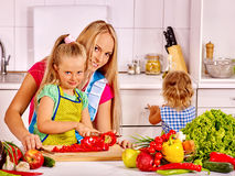Mother and daughter cooking at kitchen Stock Photography