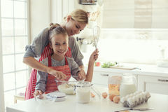Mother and daughter are cooking Stock Photos