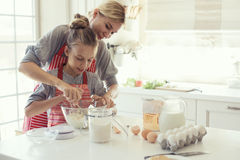 Mother and daughter are cooking Stock Image