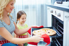 Mother and daughter cooking Stock Images