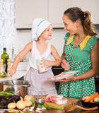 Mother with daughter cooking Stock Image