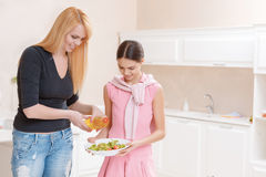 Mother and daughter cooking salad Stock Photo