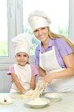 Mother and daughter cooking together Royalty Free Stock Image