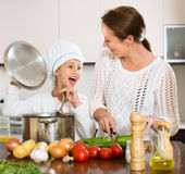 Mother and daughter cooking together Royalty Free Stock Photo