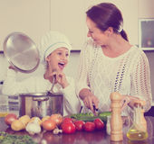 Mother and daughter cooking together Royalty Free Stock Images