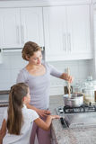 Mother and daughter cooking together Stock Image